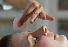 Ku Nye Facial Therapy with hot crystals.